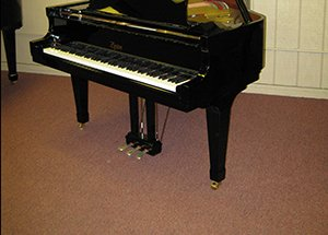 stretching carpet with piano on it
