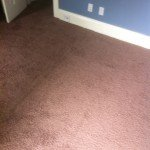 Bedroom carpet after being restretched